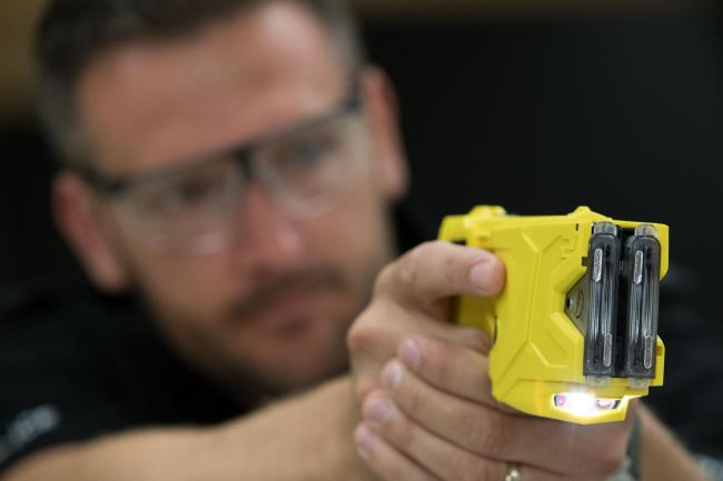 File photo dated 7/8/2017 of a taser being demonstrated. More than eight out of 10 police officers want to carry stun guns such as Tasers and would feel safer with the devices, a new poll suggests.