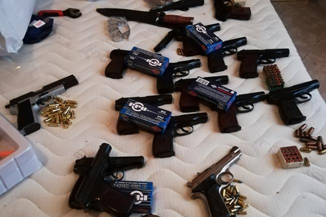 Some of the 56 guns seized in raids in the UK and Bulgaria