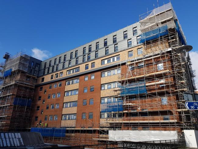 Workers installing scaffolding on student accommodation, Queens Court in Reading, ahead of removing ACM cladding. (This is not one of the hotels.)
