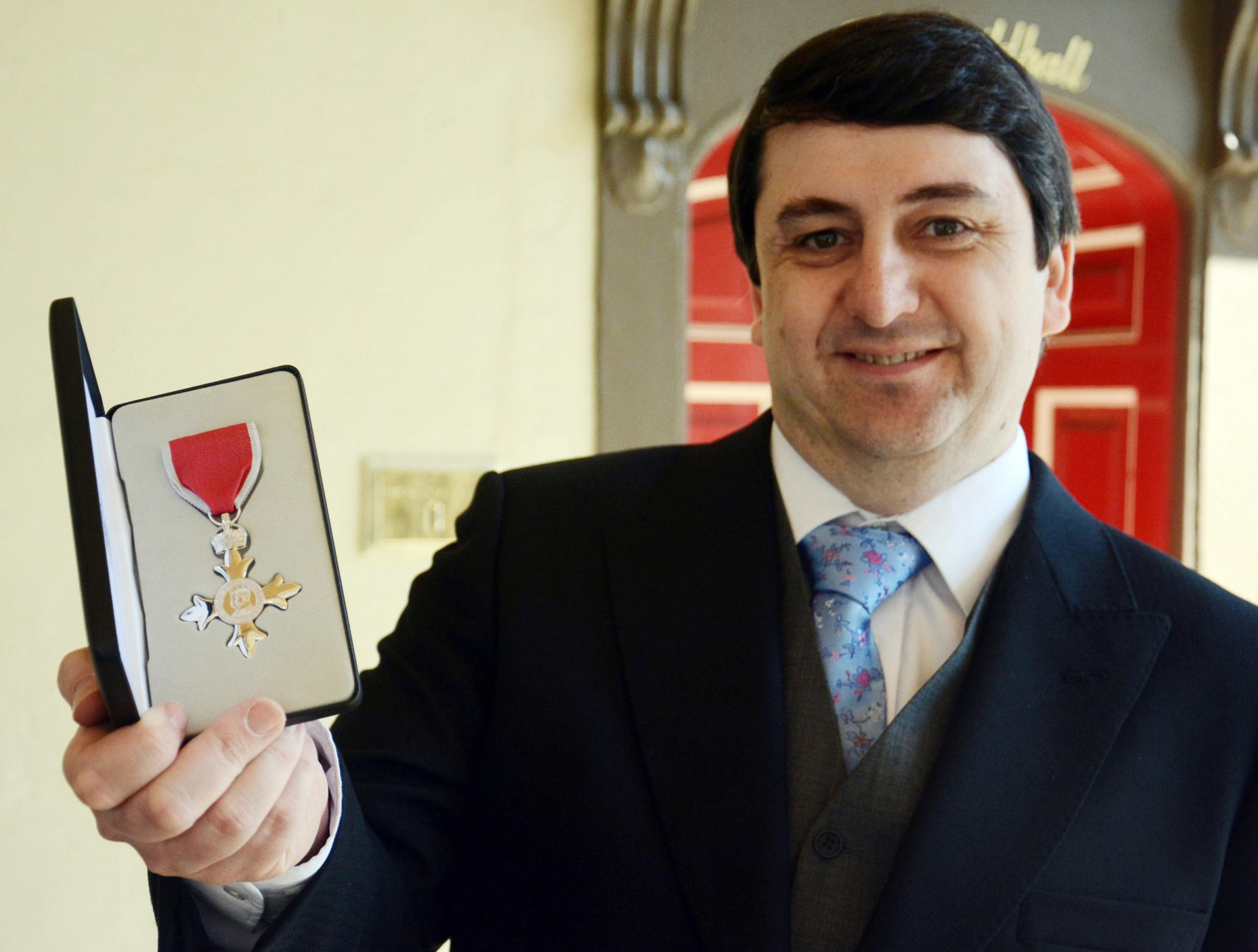 Cllr David Burbage picking up his MBE in Windsor in 2014. PHOTO: EMMA SHEPPARD