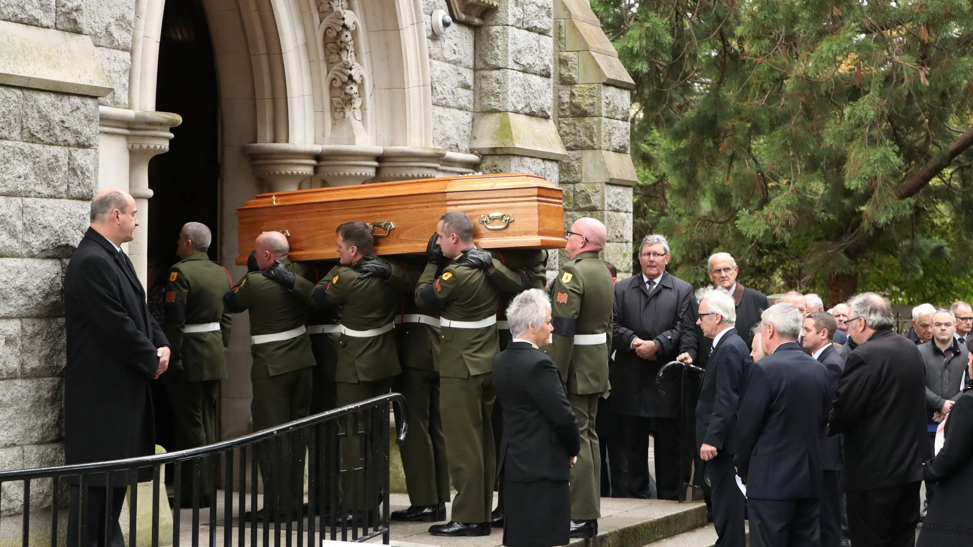 The coffin of Liam Cosgrave is carried into the Church of the Annunciation in Dublin, for his funeral service