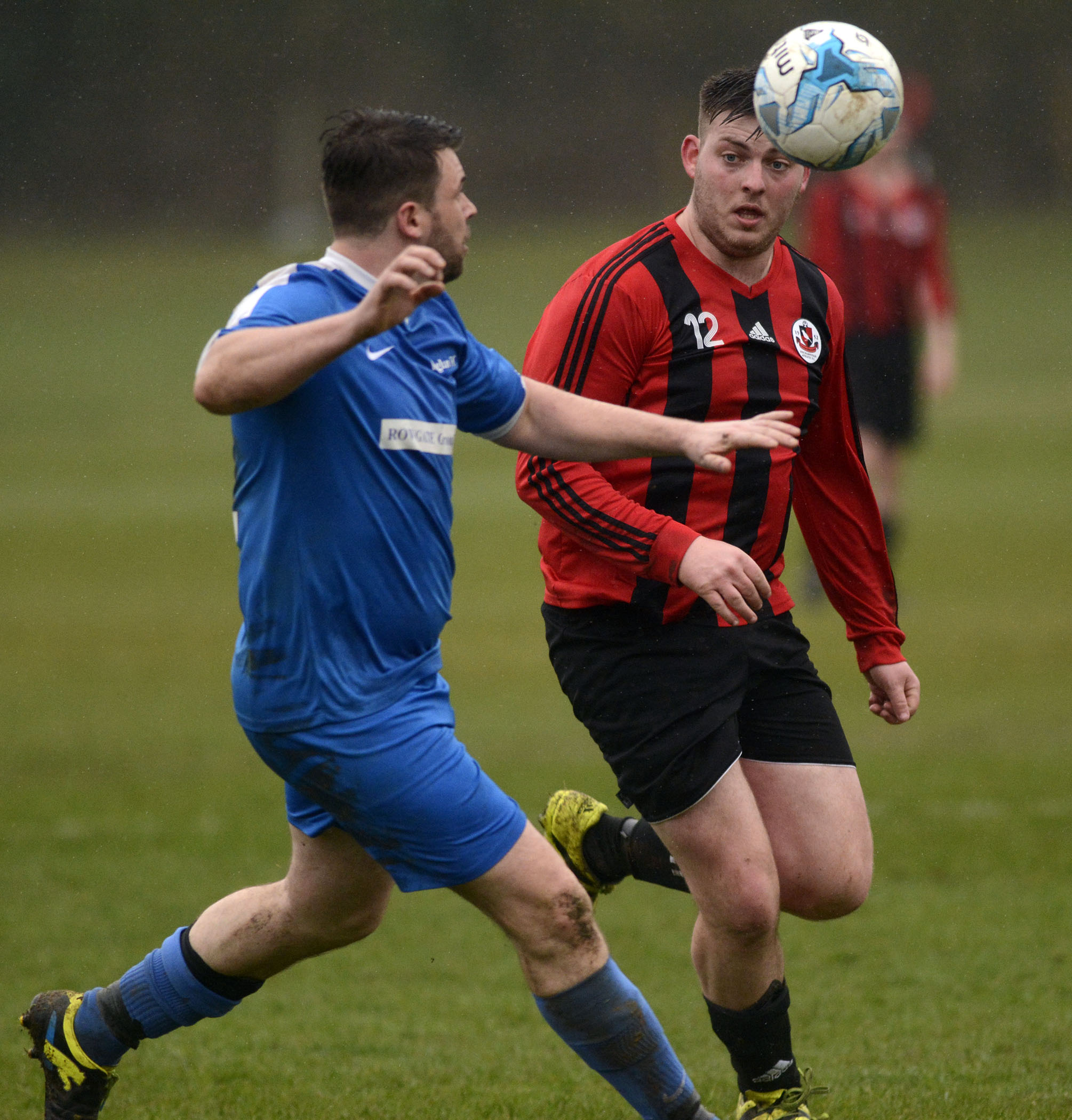 Finchampstead Athletic Reserves' (red/black) Dan Marles goes for the ball   Picture by Paul Johns 180416