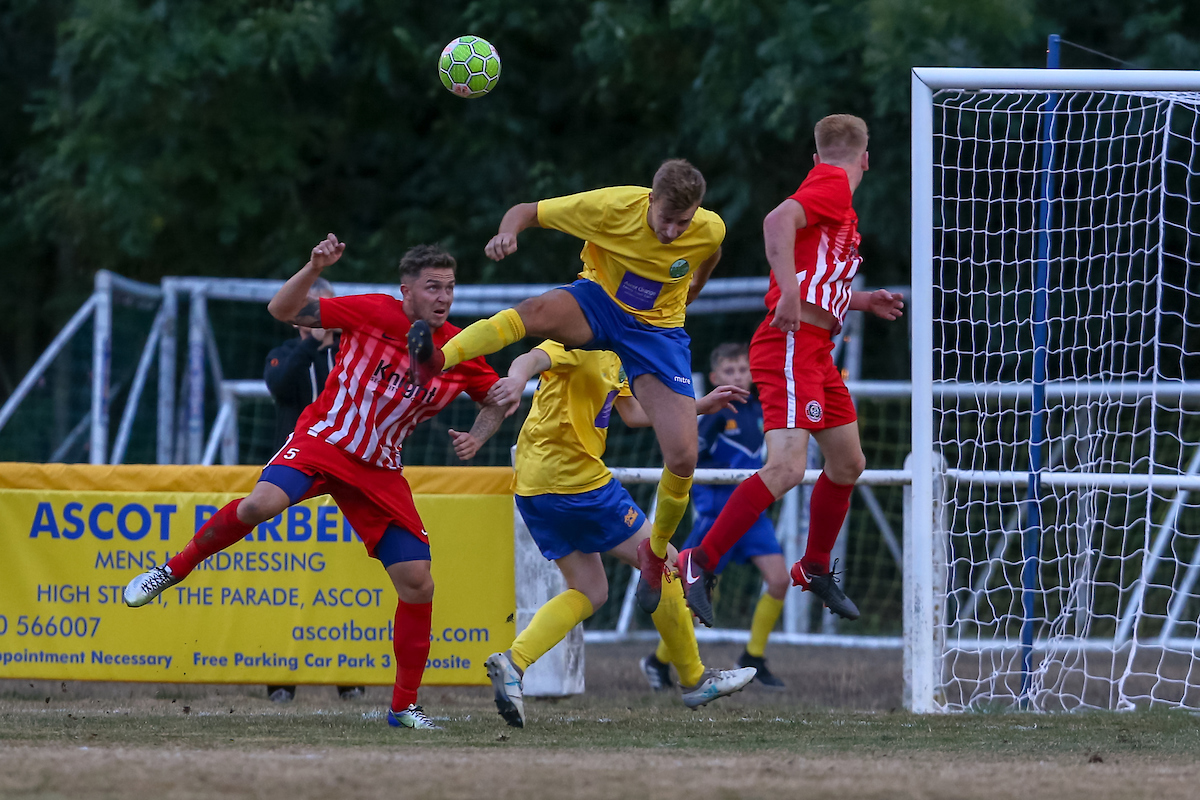 Ascot United (yellow) beat Camberley Town 2-1  Pictures by Neil Graham