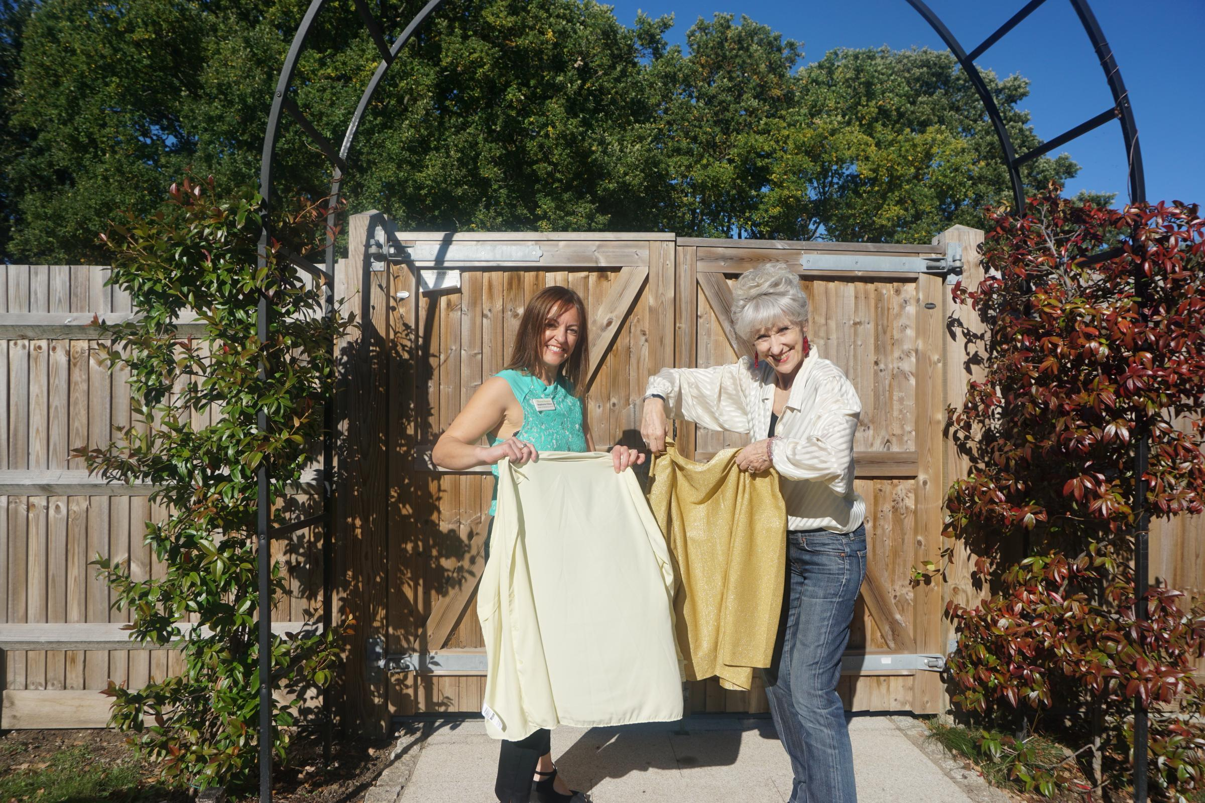 Anita Dobson and Stephanie Peters with clothes for the hospice shop