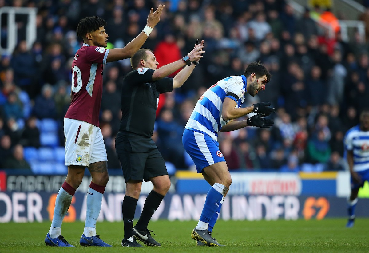 Tyrone Mings and referee Geoff Eltringham call for medical help following Nelson Oliveira's horrific facial injury.