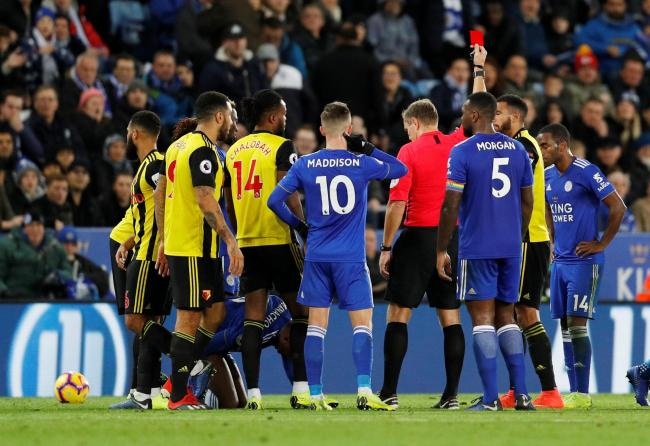Soccer Football - Premier League - Leicester City v Watford - King Power Stadium, Leicester, Britain - December 1, 2018  Watford's Etienne Capoue is shown a red card by referee Graham Scott  REUTERS/Darren Staples  EDITORIAL USE ONLY. No use with unau